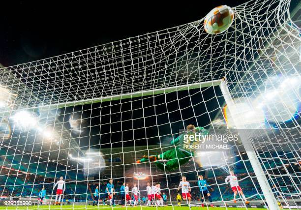 TOPSHOT Saint Petersburg´s Italian defender Domenico Criscito scores next to Leipzig´s Hungarian goalkeeper Peter Gulacsi during the Europa League...