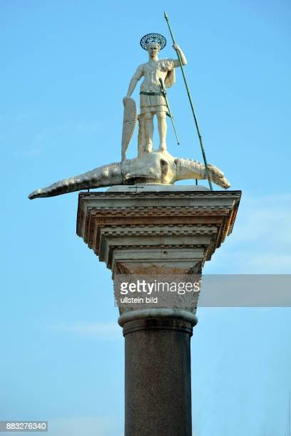 Saint Theodor statue on a column on the Piazza San Marco of Venice in Italy Colonne di San Teodoro Caution