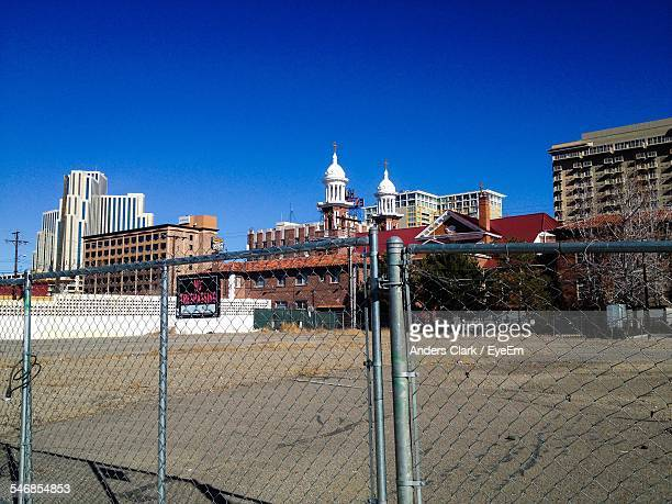 saint thomas aquinas cathedral amidst buildings seen through fence - saint thomas aquinas stock pictures, royalty-free photos & images