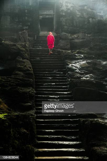 saint walking inside the ellora caves - ancient civilisation stock pictures, royalty-free photos & images