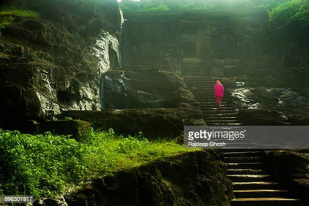 A saint walks to the caves in Ellora