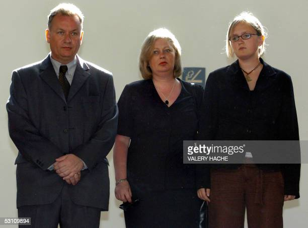 John and Susan Dickinson parents of British schoolgirl Caroline and their daughter Jenny leave the court room during a break in the retrial of...