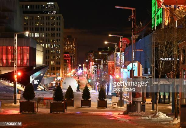 Saint-Catherine street, one of the Montreal's main commercial streets is pictured deserted moments after the curfew was implemented from 8pm local...