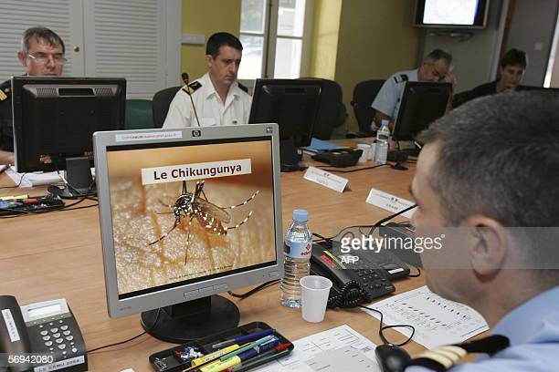 French gendarmes man a chikungunya crisis center at La Reunion island 26 February 2006 French Prime Minister announced on Sunday a multimillioneuro...