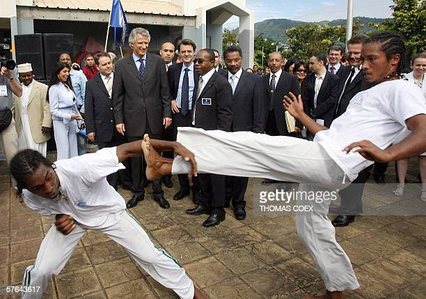 French Prime Minister Dominique De Villepin watches dancers that perform Moring a typical fighting dance during his visit to the French Indian Ocean...