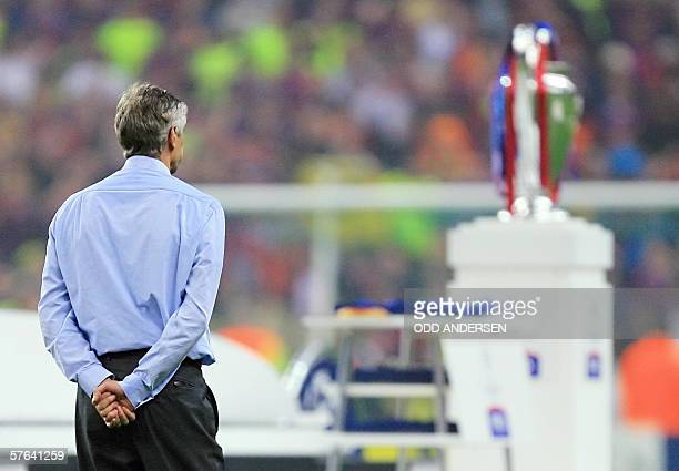 Arsenal's French coach Arsene Wenger looks at the trophy after the UEFA Champion's League final football match Barcelona vs Arsenal 17 May 2006 at...
