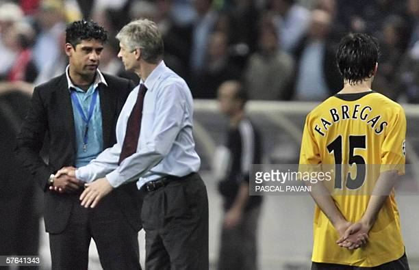 Arsenal's French coach Arsene Wenger shakes hands with Barcelona's coach Frank Rijkaard from Netherlands after the UEFA Champion's League final...