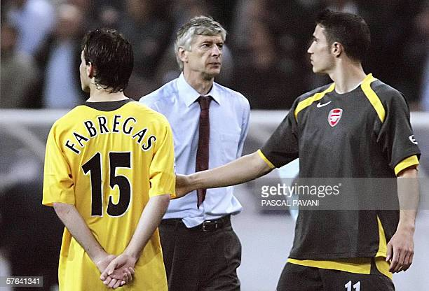 Arsenal's Spanish midfielder Cesc Fabregas and Arsenal's French coach Arsene Wenger are seen during the UEFA Champion's League final football match...