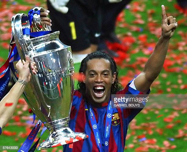Barcelona's Brazilian forward Ronaldinho celebrates with the trophy after winning the UEFA Champion's League final football match against Arsenal 17...