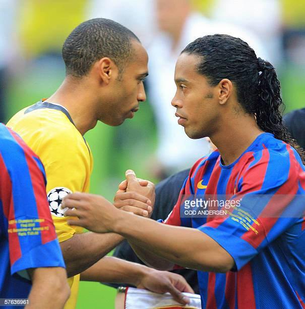 Barcelona's Brazilian forward Ronaldinho shakes hands with Arsenal's French forward and team captain Thierry Henry before the UEFA Champion's League...