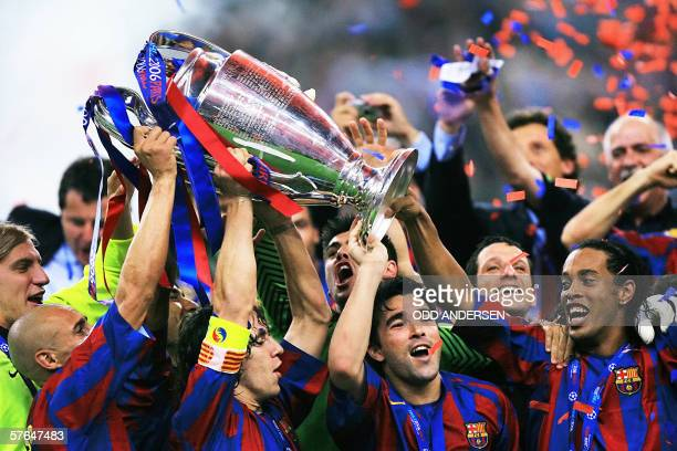 Barcelona's players celebrate with the UEFA Champion's League trophy after winning the final football match against Arsenal 17 May 2006 at the Stade...