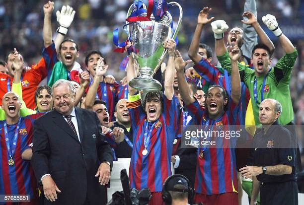 Barcelona's players hold the trophy after winning the UEFA Champion's League final football match against Arsenal 17 May 2006 at the Stade de France...
