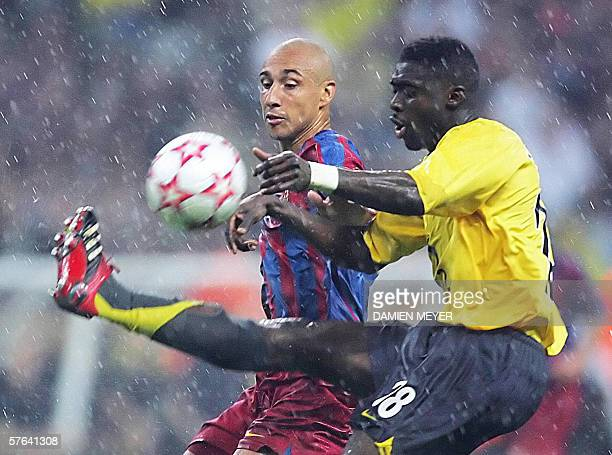 Barcelona's Swedish forward Henrik Larsson vies with Arsenal's Ivorian defender Kolo Abib Toure during the UEFA Champion's League final football...
