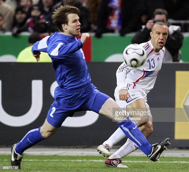 France's defender midfielder Mickael Sylvestre vies with Slovak midfielder Filip Holosko during the friendly football match France vs Slovakia as...