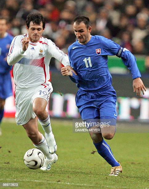 France's defender Willy Sagnol vies with Slovakia's forward and captain Robert Vittek during the friendly football match France vs Slovakia as part...