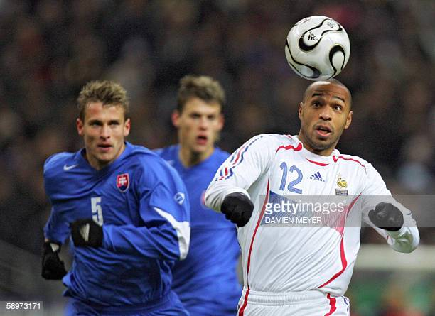 France's forward Thierry Henry vies with Slovakia's defender Marek Cech during the friendly football match France vs Slovakia as part of France's...