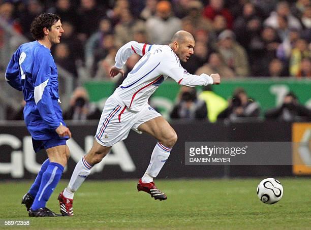 France's midfielder and captain Zinedine Zidane vies with Slovakia's midfielder Balazs Borbely during the friendly football match France vs Slovakia...