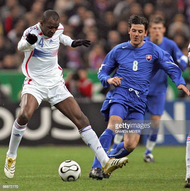 France's midfielder Patrick Vieira vies with Slovakia's defender Peter Hlinka during the friendly football match France vs Slovakia as part of...