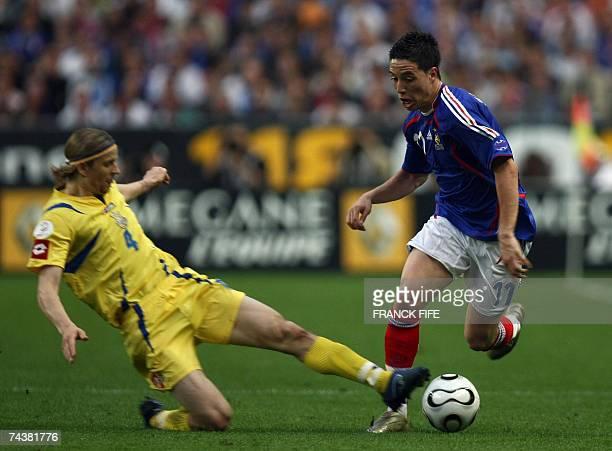 France's midfielder Samir Nasri vies with Ukraine's midfielder Anatoly Timoshchuk during their Euro2008 qualification football match at the Stade de...