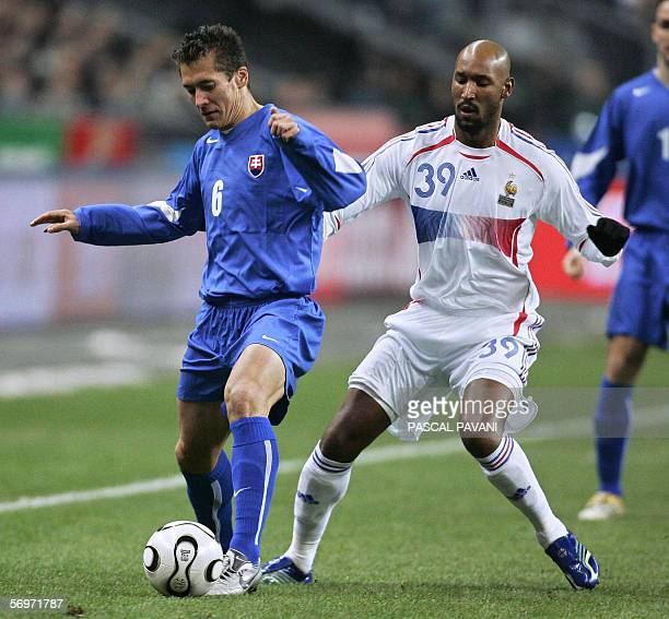 French forward Nicolas Anelka vies with Slovak defender Marek Cech during the friendly football match France vs Slovakia as part of France's Fifa...