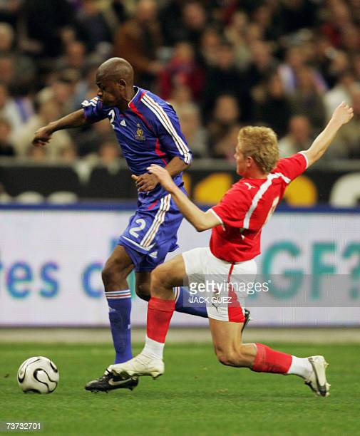 French midfielder Abou Diaby vies with Austrian midfielder Austrian midfielder Thomas Prager during the friendly football match France vs Austria 28...