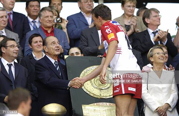 French president Jacques Chirac shakes hands with Biarritz Olympique's fullback Nicolas Brusque after the French championship rugby union final match...