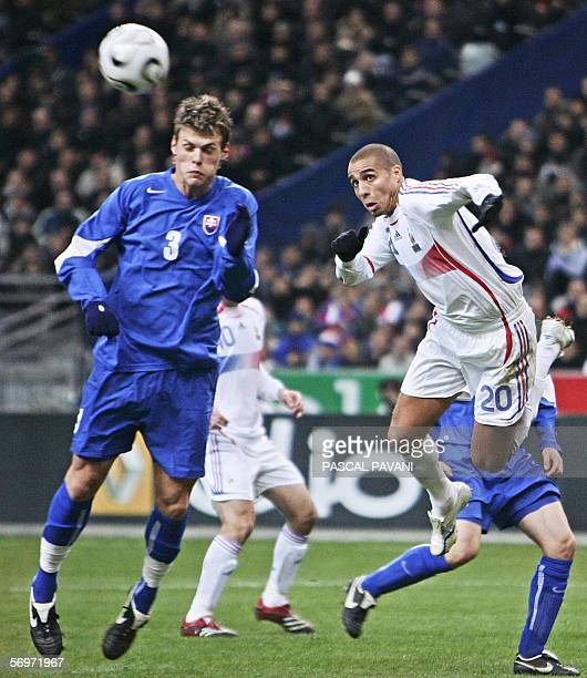 French's forward David Trezeguet vies with Slovak defender Martin Skrtel during the friendly football match France vs Slovakia as part of France's...