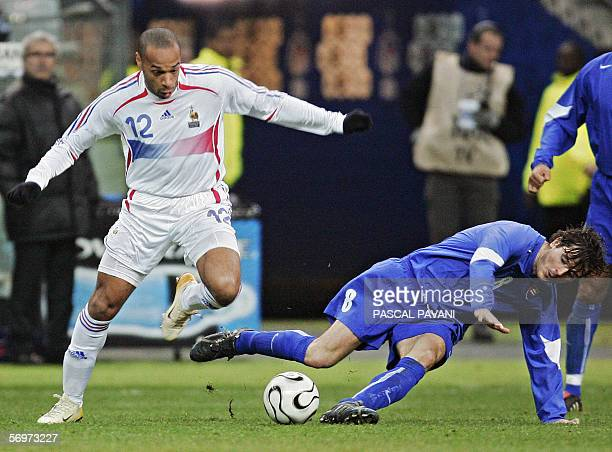 French's forward Thierry Henry vies with Slovak midfielder Balazs Borbely during the friendly football match France vs Slovakia as part of France's...