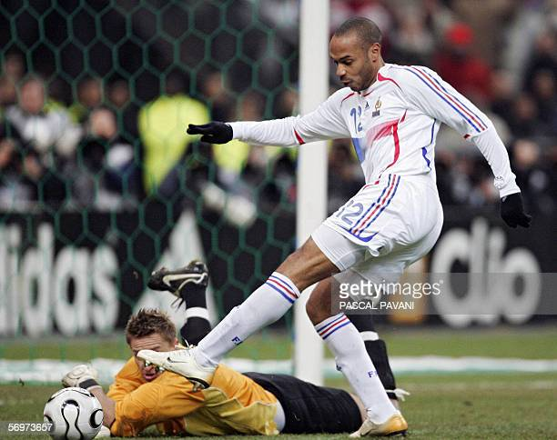 French's forward Thierry Henry vies with Slovak Goalkeeper Lubos Hajduch during the friendly football match France vs Slovakia as part of France's...