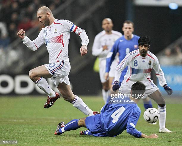 French's midfielder Zinedine Zidane is tackled by Slovak defender Peter Hlinka during the friendly football match France vs Slovakia as part of...
