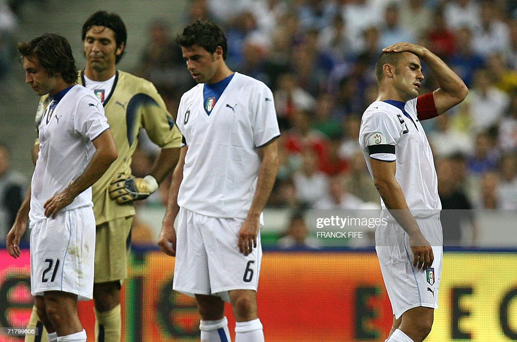 Italian midfielder Andrea Pirlo, goalkeeper Gianluigi Buffon, defender Andrea Barzagli and defender and captain Fabio Cannavaro look dejected at the end of the 2008 UEFA European Cup Group B qualifying match France vs Italy, 06 September 2006 at the Stade de France in Saint-Denis, north Paris. France won 3-1.