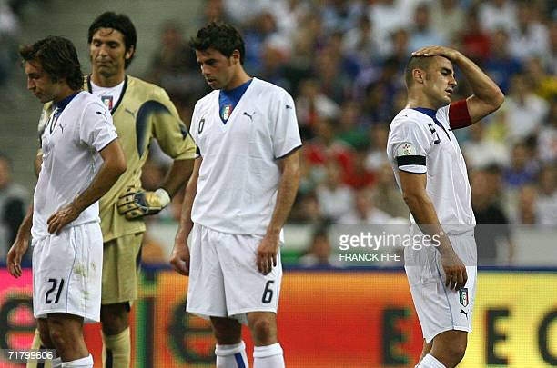 Italian midfielder Andrea Pirlo goalkeeper Gianluigi Buffon defender Andrea Barzagli and defender and captain Fabio Cannavaro look dejected at the...