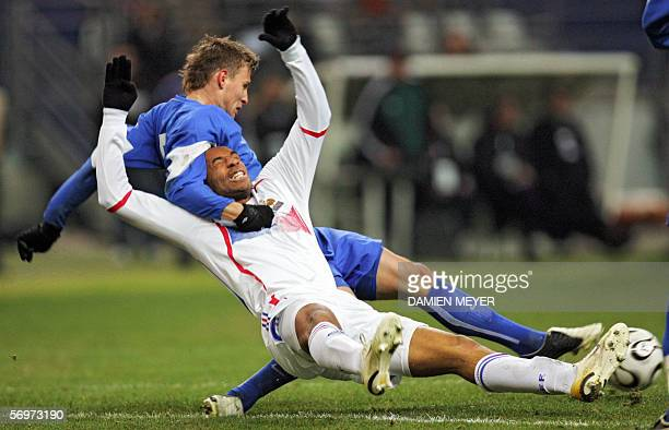 Slovakia's midfielder Matej Krajcik vies with France's forward Thierry Henry during the friendly football match France vs Slovakia as part of...