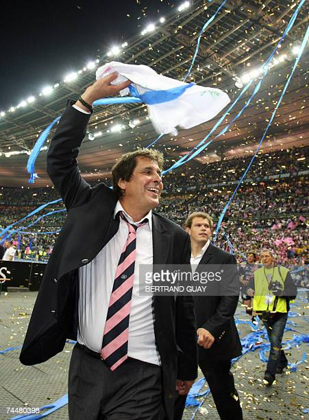 Stade Francais' president Max Guazzini celebrates after his team won against ASM Clermont the final of the French rugby union Top 14 championship, 09...