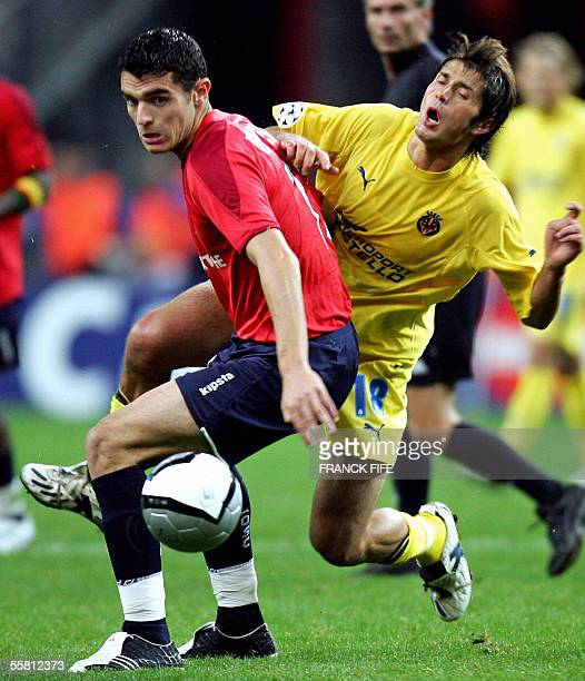 Villareal's Italian midfielder Alessio Tacchinardi vies with Lille's forward Nicolas Fauvergue during their Champions league group D football match...