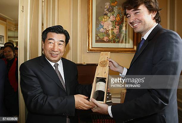 China's agriculture minister Huy Liangyu who is also a deputy premier is offered a Chateau Yquem 1944 by Antoine Arnault son of Bernard Arnault the...