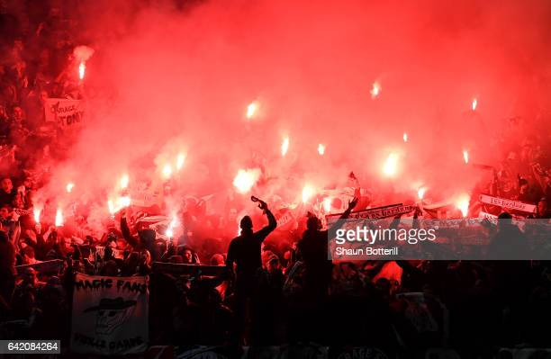 SaintEtienne fans show their support during the UEFA Europa League Round of 32 first leg match between Manchester United and AS SaintEtienne at Old...