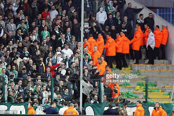 Saint Etienne's supporters overrun in the Lyon's supporters gallery during their French L1 football match Saint Etienne vs Lyon 03 march 2007 at the...