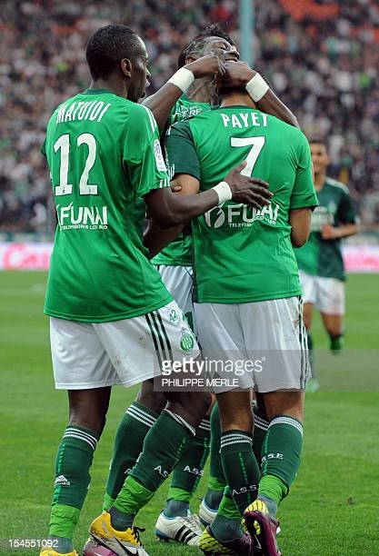 SaintEtienne French forward Dimitri Payet is congratulated by his teammates after scoring a goal during the French L1 football match SaintEtienne vs...