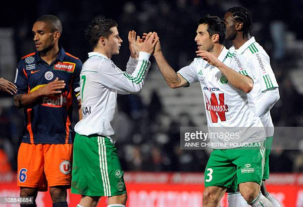SaintEtienne players celebrate after winning the French L1 football match Montpellier vs SaintEtienne on February 5 2011 at the Stade de la Mosson in...