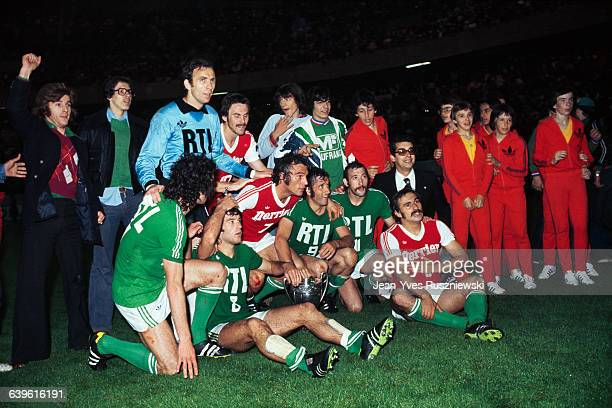 SaintEtienne soccer players celebrate with their trophy following their victory against Reims in the 19761977 French Cup Final ASSE won 21