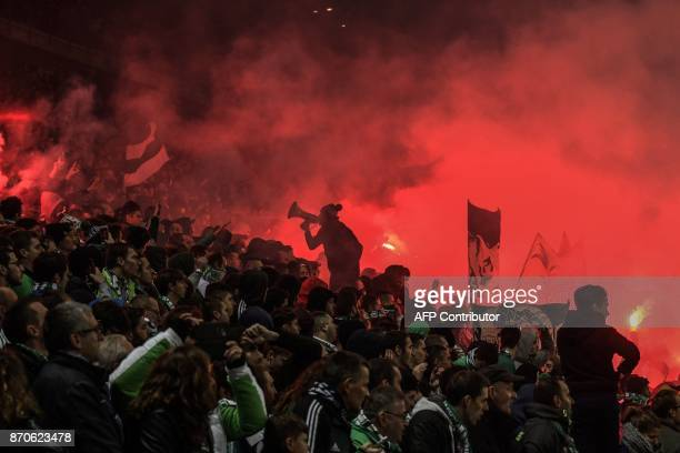 TOPSHOT SaintEtienne supporters are pictured during the L1 football match AS SaintEtienne vs Olympique Lyonnais on November 5 at the Geoffroy...