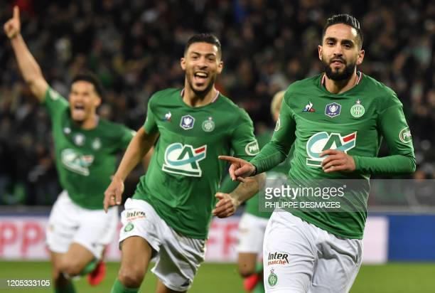 SaintEtienne's Algerian midfielder Ryad Boudebouz celebrates after scoring a goal next to SaintEtienne's Gabonese forward Denis Bouanga during the...