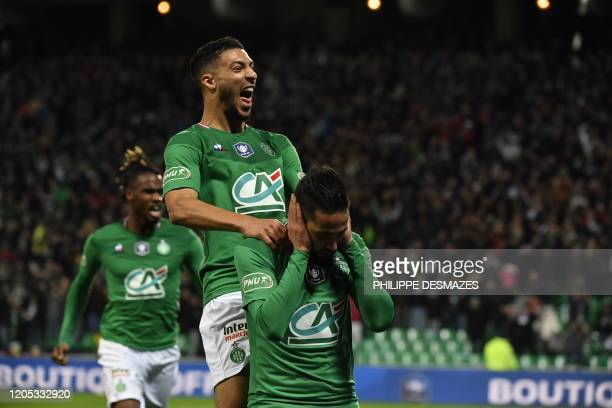 SaintEtienne's Algerian midfielder Ryad Boudebouz is congratuled by teamate SaintEtienne's Gabonese forward Denis Bouanga after scoring a goal during...