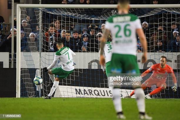 Saint-Etienne's Algerian midfielder Ryad Boudebouz shoots and scores a penalty kick past Strasbourg's Belgian goalkeeper Matz Sels during the French...