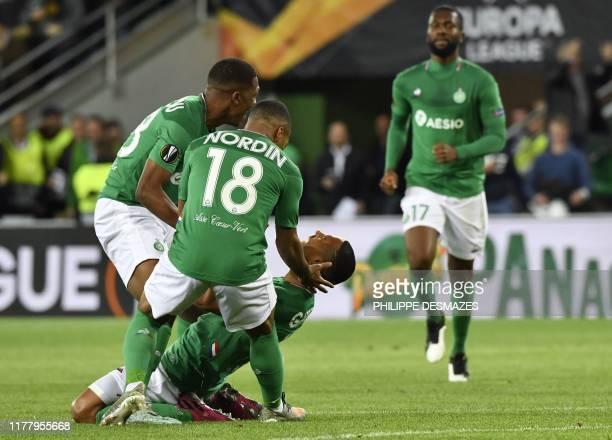 SaintEtienne's Brazilian defender Gabriel Silva is congratuled by teammates SaintEtienne's French midfielder Mandi Camara and SaintEtienne's French...