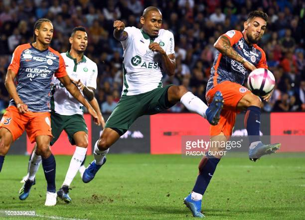 SaintEtienne's Brazilian defender Gabriel Silva vies with Montpellier's French forward Andy Delfort during the French L1 football match between...