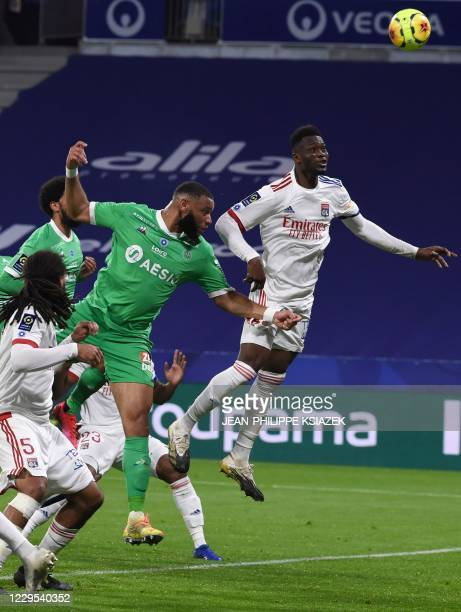 SaintEtienne's Camerounian defender Harold Moukoudi fights for the ball withLyon's French defender Sinaly Diomande during the French L1 football...