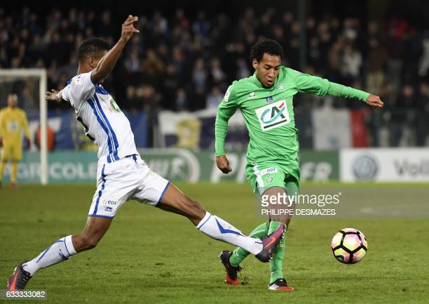 SaintEtienne's Cape Verdean forward Kenny Rocha Santos vies with Auxerre's French defender KenjiVan Boto during the French Cup football match AJ...