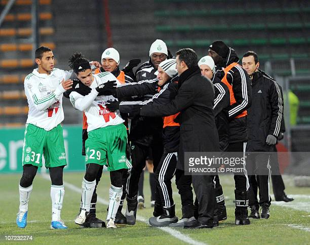 SaintEtienne's Emmanuel Riviere is congratulated by teammates after scoring a goal during the French L1 football match Valenciennes vs SaintEtienne...